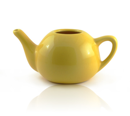 A simplistic yellow ceramic teapot photo
