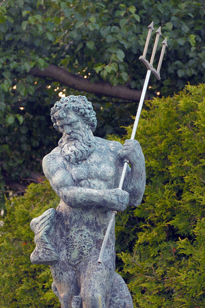 Awesome Poseidon statue with trident also known as Neptune Stock Photo