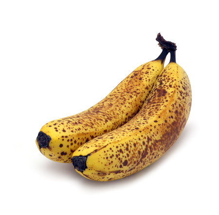 Brown spotted bananas that are just right for baking isolated on white