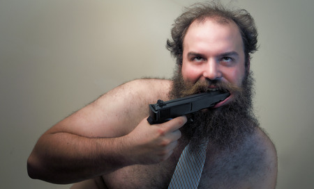 crazed: A crazed businessman loses his shirt and holds a gun to his mouth