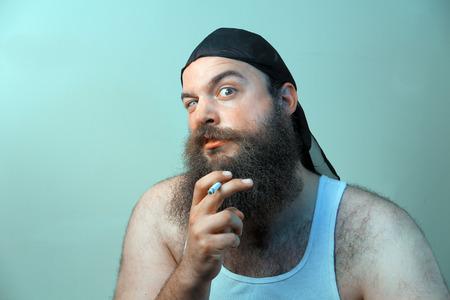 A smoking redneck questions his beliefs