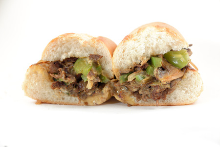 Messy philly cheese steak with mushrooms onions and peppers