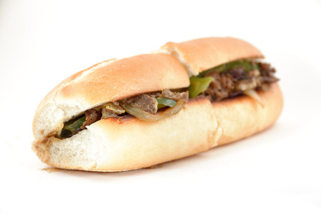 Messy Philly cheese steak with mushrooms onions and peppers Reklamní fotografie
