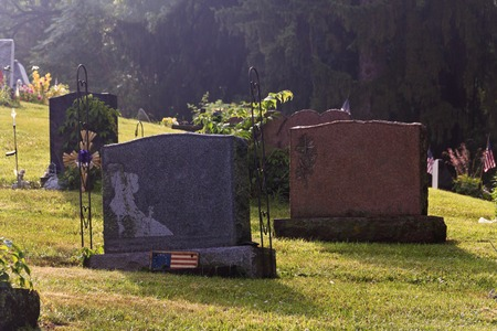 unnamed: Blank graves early morning with american flags Stock Photo