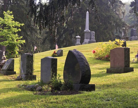 Blank graves in a graveyard in early morning