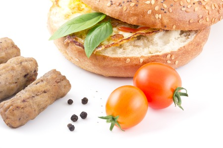 Yummy healthy everything bagel with sausage and cherry tomatoes photo