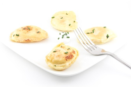 Delicious authentic polish pierogies with chives and Greek yogurt