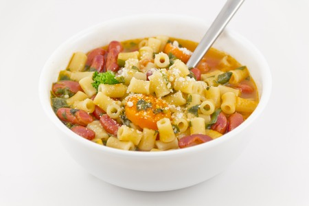 Delicious pasta fagioli ready to be eaten with parmesan cheese to top