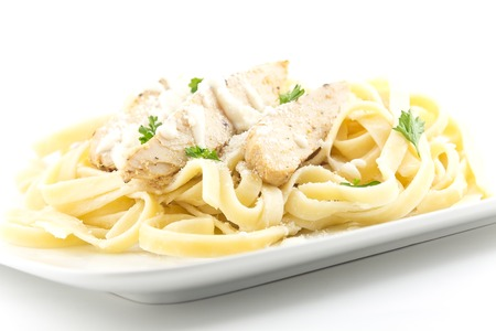 Chicken Fettuccini alfredo with fresh curly parsley Stok Fotoğraf - 30561156