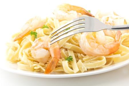 alfredo: shrimp Fettuccini Alfredo with fresh parsley leaves in fancy arrangement