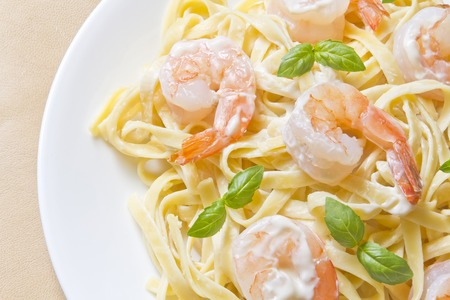 shrimp Fettuccini Alfredo with fresh basil leaves in fancy arrangement Stok Fotoğraf