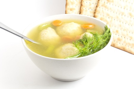 matzo balls: Delicious Matzoh ball soup with crackers wine and dill