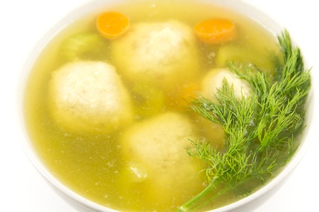 Delicious Matzoh ball soup with crackers wine and dill