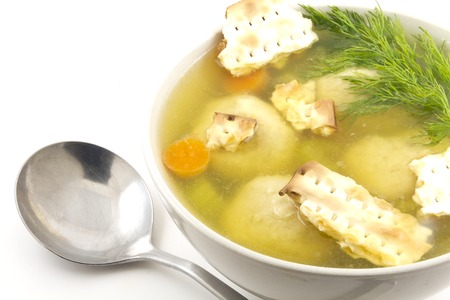 matzoh: Delicious Matzoh ball soup with crackers wine and dill