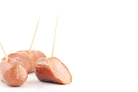 sampler: Sliced sizzling hotdogs with toothpicks sampler platter