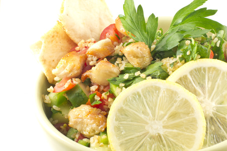 tabbouleh: Healthy fresh chicken tabbouleh salad with pita chips Stock Photo