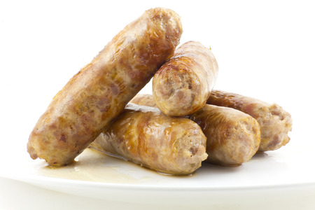 Cooked fried Italian sausage links isolated on white