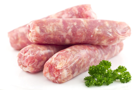 Raw Italian sausage isolated on white with parsley ready to cook Stok Fotoğraf - 31363087