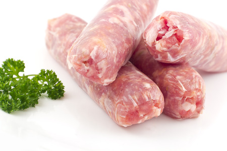 Raw Italian sausage isolated on white with parsley ready to cook Stok Fotoğraf - 31363109