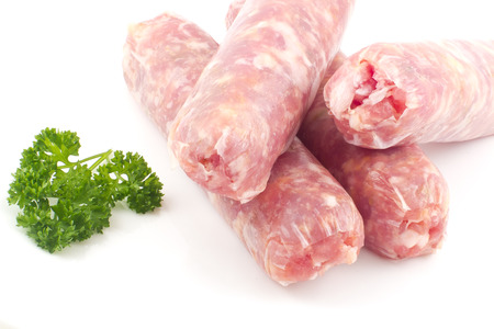 Raw Italian sausage isolated on white with parsley ready to cook Stok Fotoğraf