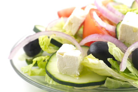 Fresh greek salad with feta cheese cubes and black olives