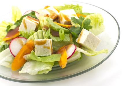 Tofu salad with radishes, carrots, scallions, and coriander