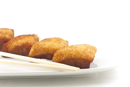Chinese shrimp toast arranged simple and delightfully isolated on white