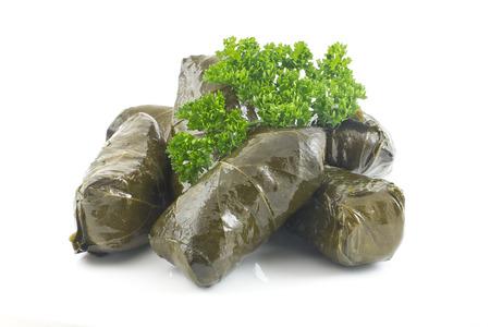 Armenian yaprak dolma, stuffed grape leaves garnished with fresh parsley  Imagens