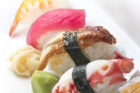 prepared shrimp: Assorted sushi platter including, octopus, eel, tuna, shrimp, and salmon