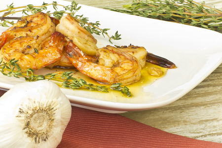 ajillo: Authentic Portuguese Garlic Shrimp garnished with rosemary and thyme
