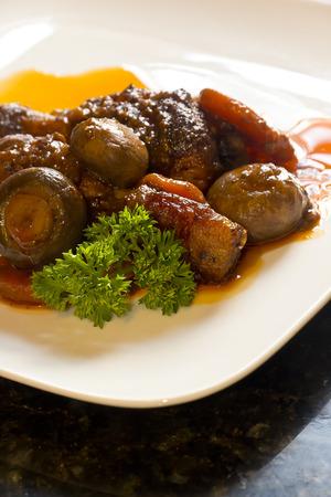 au: French cuisine, Coq Au Vin, crimini mushrooms, carrots, with wine sauce