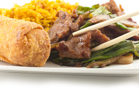 egg roll: Take out Chinese sauteed fried beef strips with scallion served with an egg roll and pork fried rice Stock Photo