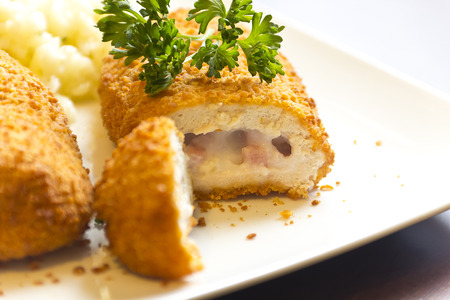 Breaded stuffed chicken cordon bleu with green peas white rice and parsley for garnish Stok Fotoğraf - 35252825