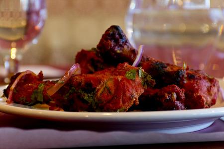 Tandoori chicken with basmati rice and lime wedge