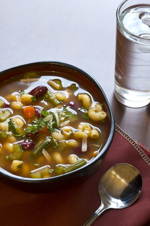 grate: Hearty winter minestrone soup and glass of refreshing water