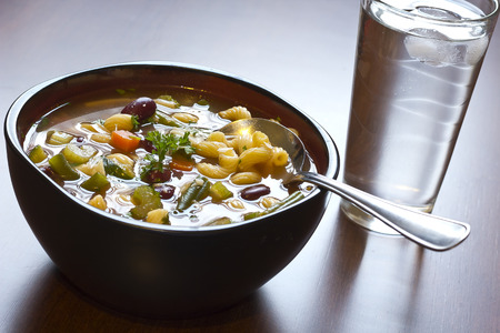 minestrone: Hearty winter minestrone soup and glass of refreshing water