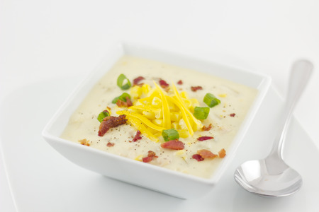 scallions: Corn chowder with scallions bacon and grated cheddar Stock Photo