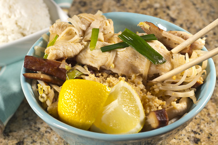 Delicious Chicken Pad Thai with lemon and white rice