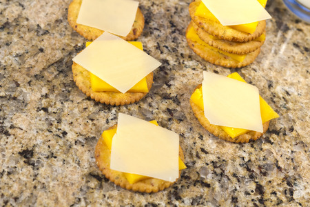 Snack of crackers and yellow and white cheddar cheese and cold milk Reklamní fotografie