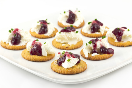 Snack plate of crackers topped with whipped cream cheese and grape Jelly Reklamní fotografie
