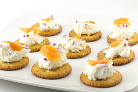 lochs: Snack plate of crackers topped with whipped cream cheese and smoked salmon