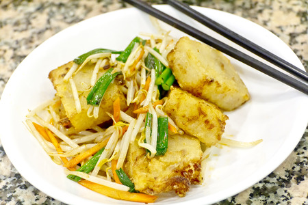 bean sprouts: Chinese pan fried turnip cakes, Law Bock Gow, with bean sprouts and scallion