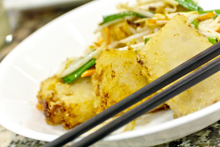 scallion: Chinese pan fried turnip cakes, Law Bock Gow, with bean sprouts and scallion