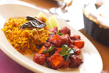 paneer: Crispy spicy Kadai Paneer Tofu with tamarind rice and lime wedges Stock Photo