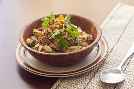 nutty: Healthy nutty Quinoa and Bacon Salad with toasted sliced almonds and parsley