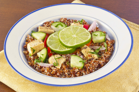 crushed red peppers: Red Quinoa Tabbouleh salad with juicy grilled chicken and cucumbers with chopped parsley