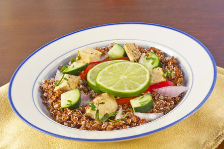 Red Quinoa Tabbouleh salad with juicy grilled chicken and cucumbers with chopped parsley