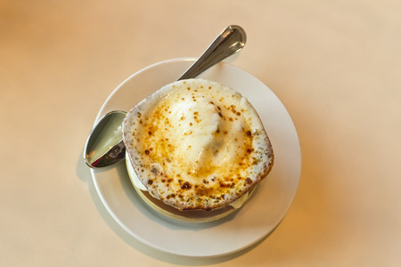 fench: French onion soup with crispy gruyere cheese baked to perfection
