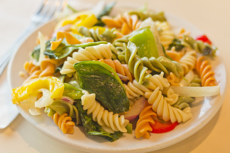 Delightful and vibrant tricolor pasta salad with healthy vegetables photo