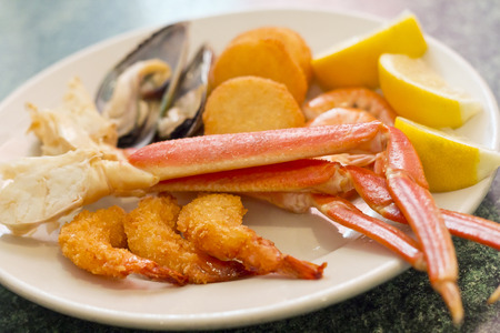 crab legs: Seafood medley including crab legs breaded shrimp muscles and fried scallops